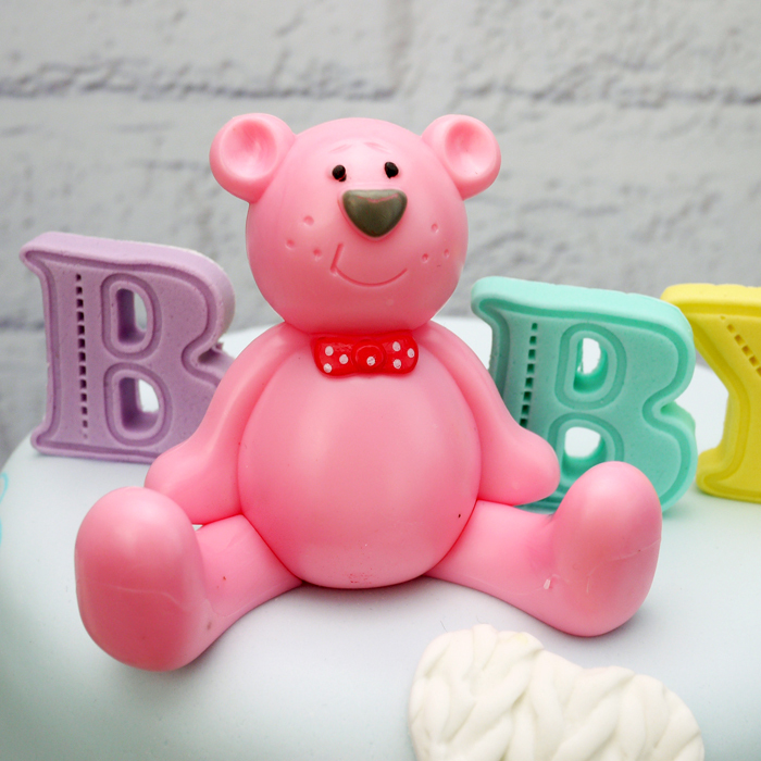 Pink Plastic Teddy (Wearing A Bow Tie)