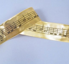 1 Metre Length Of Gold  Ribbon With Black Musical Notes